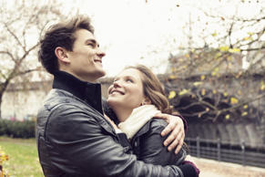 young couple,s, embracing,happy together,its autumn, woman looks up to man