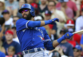 Toronto Blue Jays' Jose Bautista follows through on a two-run single during the eighth inning of a baseball game against the Toronto Blue Jays in Boston.