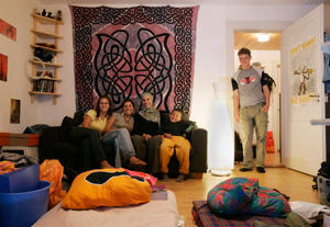 Rafeal Nussbaum (R) from Switzerland poses with his guests Renee Miller from U.S., Elena Tedeschi from Italy, Stephanie Ladel and Oussama Refas from France(L-R) at his apartment in Bern.