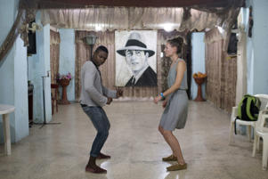 Mechanic and salsa dance instructor Ariel Domninguez gives a class to Jarman Frash, a medical student from Germany in Havana.