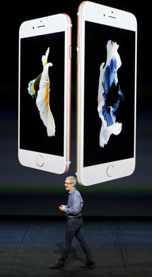 Apple CEO Tim Cook introduces the iPhone 6s and iPhone 6s Plus during an Apple media event in San Francisco, California, September 9, 2015.
