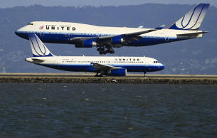 United Airlines planes take off and land at San Francisco airport, California January 21, 2012.