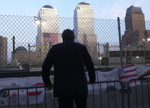A city worker looks out over the site of Ground Zero in New York ahead of the memorial service to mark the first anniversary of the terrorist attacks on the World Trade Center.
