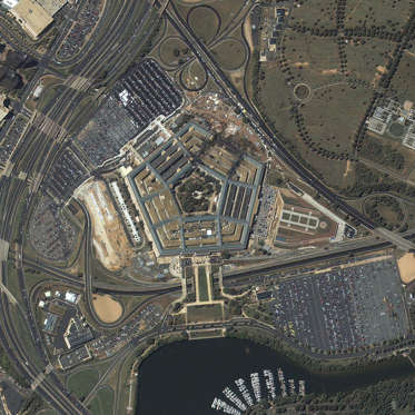 A satellite image of the Pentagon was taken at 11:46 a.m. EDT September 12, 2001 by the IKONOS satellite over Washington D.C. The image shows extensive damage to the western side and interior rings of the multi-ringed building. Since all airplanes were grounded over the U.S. after the attack, IKONOS was the only commercial high-resolution camera that could take an overhead image at the time.