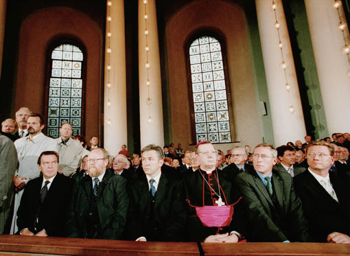 394298 05: German Chancellor Gerhard Schroeder (L) attends a memorial service for victims of the terrorist attacks on the United States, September 12, 2001 at St. Hedwig's Cathedral in Berlin, Germany, one day after terrorists attacked the World Trade Center in New York and the Pentagon in Washington, DC.