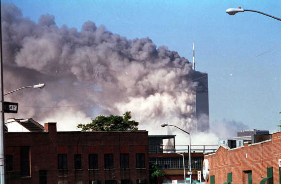 A view of World Trade Center Towers after a hijacked flight assault on each structure in lower Manhattan. The photographs were taken in the Greenpoint section of Brooklyn.