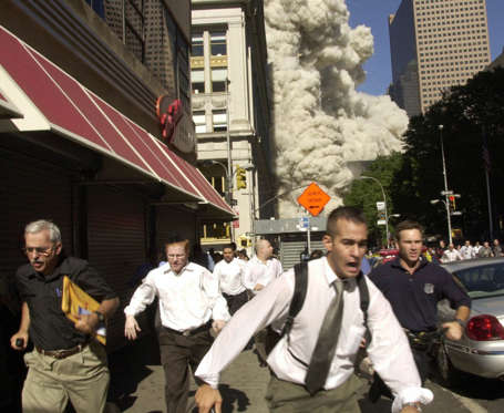 FILE - In this Sept. 11, 2001 file photo, people run from a collapsing World Trade Center tower in New York. For over a decade after the autumn of 2001, America, with its allies, has been at war against factions of Islamist militants and terrorists, including the Taliban and al-Qaida, as well as offshoots in Yemen, Somalia and elsewhere. (AP Photo/Suzanne Plunkett, File)
