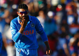 India's Ravindra Jadeja blows a kiss to teammate Virat Kohli, who captured West Indies' last wicket Jason Holder, during his Cricket World Cup match in Perth, March 6, 2015.