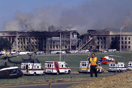 394422 05: Smoke And Flames Rise Over The Pentagon At About 10 A.M. Est September 11, 2001 Following A Suspected Terrorist Crash Of A Hijacked Commercial Airliner Into The South Side Of The Pentagon In Arlington, Va. The Attack Came At Approximately 9:40 A.M. As The Plane, Originating From Washington D.C.'s Dulles Airport, Was Flown Into The Southern Side Of The Building. (Photo By U.S. Navy/Getty Images)
