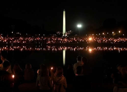 Thousands of people take part in a candlelight vigil on the Mall, in Washington D.C. September 12, 2001, in memory of the victims of the terrorist attacks in New York City and Washington D.C. The United States vowed on Wednesday to strike back for the September 11 attacks on the World Trade Center and the Pentagon, described across an angry nation as ``an act of war'' committed by an enemy whose name it doesn't even know.