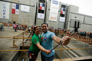 Max Roth and Susye Roth take a selfie while inside the expanded Panama canal's new set of locks before they are flooded, in Cocoli, near Panama City.