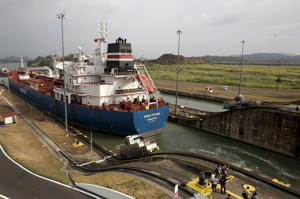 A cargo ships crosses the Miraflores locks in the Panama Canal in Panama City.
