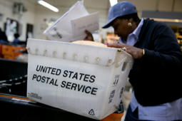 U.S. Postal Service (USPS) letter carrier Sharon Herbert sorts mail before delivery at the Brookland Post Office in Washington, D.C.