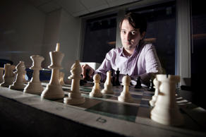 Martin Shkreli, chief investment officer of MSMB Capital Management, sits behind a chess board in New York, U.S., on Wednesday, Aug. 10, 2011.