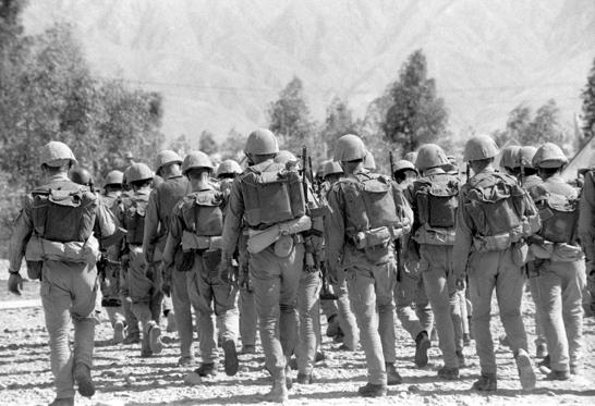 Slide 1 of 17: In conformity with the geneva accords the return home of the limited contingent of the soviet troops from afghanistan started on may 15,1988, file picture shows withdrawal of the last troops from jalalabad's land in 1989. (Photo by: Sovfoto/UIG via Getty Images)