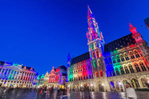 Tourists visiting famous Grand Place (Grote Markt) the central square of Brussels.