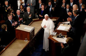 Speaker of the House John Boehner (R) and Vice President Joe Biden (R, top) applaud as Pope Francis arrives to give his speech to the U.S. Congress in Washington, September 24 2015.