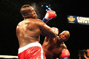 errance Marbra (R) lands a right hand to the head of Ernest Zeus Mazgck during their heavyweight boxing match at the Hard Rock Hotel on September 5, 2015 in Hollywood, Florida.