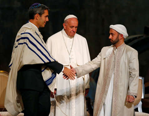 Pope Francis looks on as Jewish and Muslim representatives shake hands as he visits the National September 11 Memorial & Museum in New York on Sept. 25, 2015. Tony Gentile/Reuters