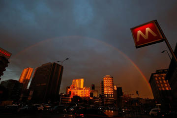 A rainbow over the buildings in downtown Milan, Italy, on September 23.