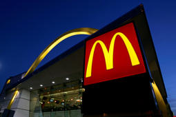 A McDonald's restaurant logo and golden arch is seen lit in Chicago.