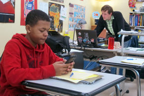 Kiante Hampton logs onto Twitter for a classroom exercise at Wauwatosa West High School in Wauwatosa, Wis., in Jan, 2014.