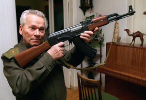 FILE - In this Wednesday, Oct. 29, 1997 file photo Mikhail Kalashnikov shows a model of his world-famous AK-47 assault rifle at home in the Ural Mountain city of Izhevsk, 1000 km (625 miles) east of Moscow. The designer of the world's most prolific firearm, the AK-47 assault rifle, has written a sorrowful letter to the Russian Orthodox Church's head, asking if he's to blame for the deaths of those killed by his creation. According to a Monday, Jan. 13, 2014 report in the daily Izvestia, several months before his death last month at age 94, Kalashnikov wrote to Patriarch Kirill that he keeps asking himself if he's responsible for those deaths. (AP Photo/Vladimir Vyatkin, File)