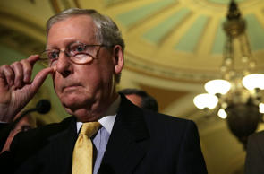 U.S. Senate Majority Leader Sen. Mitch McConnell (R-KY) adjusts his eye glasses ...