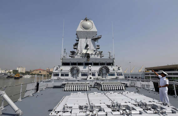 File: An Indian Navy personnel gestures on the deck of the newly built INS Kochi, a guided missile destroyer, during a media tour at the naval dockyard in Mumbai, India September 28, 2015. The warship which will be commissioned on Wednesday is the second ship in the Indian Navy to have multi-function surveillance and threat alert radar to provide information about targets for a long-range surface-to-air missile system, according to a media release issued by the Indian Navy.