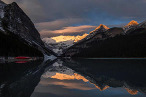 Canoes are seen on a dock on Lake Louise at Banff National Park, in the Canadian Rocky Mountains outside the village of Lake Louise, Alberta, October 3, 2014. REUTERS/Mark Blinch (CANADA - Tags: ENVIRONMENT SOCIETY)