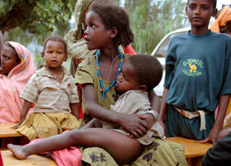 An Ethiopian girl cradles her malnourished brother at a distribution centre near Harar, in eastern Ethiopia.