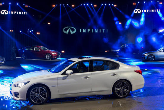 "The new Infiniti Q50 sports sedan is seen during its launching in Hong Kong in this May 22, 2014 file photo. Nissan Motor Co is looking to give its Infiniti premium brand a design makeover that will dilute its Japanese roots and flaunt a more ""passionate"" Latin feel. The bold initiative aims to rev up an upscale brand that has struggled to establish itself in a competitive global market for premium autos. REUTERS/Tyrone Siu/Files (CHINA - Tags: BUSINESS TRANSPORT)"