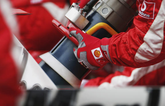 AL MANAMHA, BAHRAIN - MARCH 11: A fuel hose is seen as a Ferrari pit crew practice a pit stop practice after qualifying for the Bahrain Formula One Grand Prix at the Bahrain International Circuit on March 11, 2006 in Sakhir, Bahrain. (Photo by Clive Mason/Getty Images)