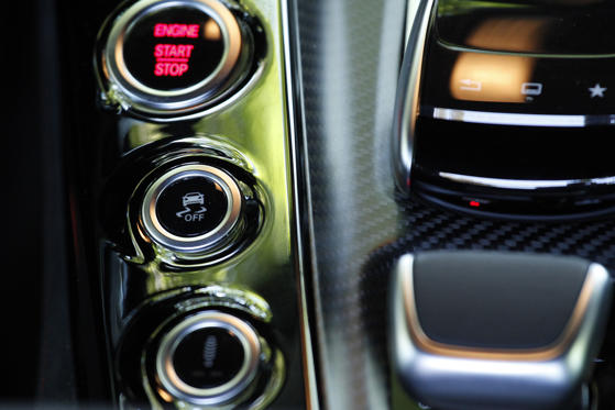 LOS ANGELES, CA - JUNE 25: A detail of the center console array showing engine on / off (top), traction control and suspension settings. The 2016 Mercedes-AMG GT S is powered by a twin-turbo V8 making 503 horsepower. It boasts a top speed of 193 mph and has an MSRP of $130,825. (Photo by Myung J. Chun/Los Angeles Times via Getty Images)