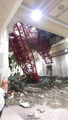 A general view from inside the Grand Mosque showing a part of a large crane that collapsed on the mosque on September 11, 2015. The civil defense authority of Saudi Arabia has confirmed at least 52 casualties with some 30 people injured in the accident.