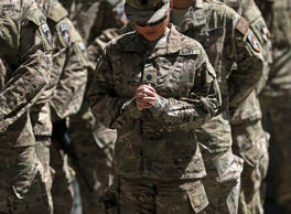 A U.S. soldier prays during a ceremony marking the 14th anniversary of the 9/11 attacks on the United States, in Kabul, Afghanistan, September 11, 2015.