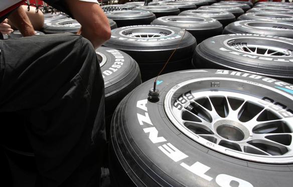 A technician installs temperature-pressure sensors in tyres ahead of the Bahrain F1 Grand Prix April 3, 2008. The Bahrain F1 Grand Prix takes place April 6. REUTERS/Caren Firouz (BAHRAIN)