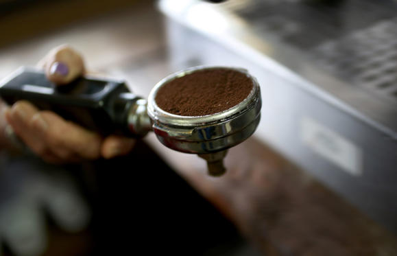 MIAMI, FL - MARCH 10: A scoop of coffee is seen as an expresso coffee is prepared for a customer at the Los Pinarenos Fruteria on March 10, 2015 in Miami, Florida. A panel of government-appointed scientists at the Dietary Guidelines Advisory Committee charged with proposing changes to U.S. dietary guidelines announced recently that three to five cups of coffee daily do not have long-term health risks, and help reduce the risk for heart disease and type 2 diabetes.