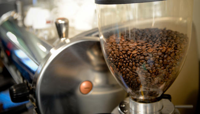 Coffee beans sit in a grinder during a class at the Barista Basics Coffee Academy in Sydney, Australia, on Monday, May 25, 2015. Once stereotyped as a land of meat pie-eaters and Foster's lager-swillers, Australia has developed a A$4 billion ($3.2 billion) coffee-drinking market that devours more fresh beans per person than any other country