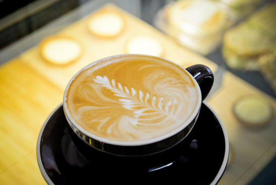 A cup of flat white coffee is arranged for a photograph during a class at the Barista Basics Coffee Academy in Sydney, Australia, on Monday, May 25, 2015. Once stereotyped as a land of meat pie-eaters and Foster's lager-swillers, Australia has developed a A$4 billion ($3.2 billion) coffee-drinking market that devours more fresh beans per person than any other country.