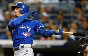 Josh Donaldson of the Toronto Blue Jays hits a two-run home run against the New York Yankees Sept. 11 in New York. The Jays won 11-5.