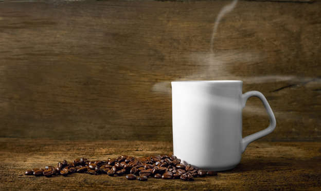幻灯片 14 - 1: Cup of coffee with smoke and coffee beans on old wooden background.