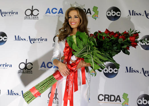 Newly crowned Miss America Betty Cantrell holds roses at the 2016 Miss America pageant, Sunday, Sept. 13, 2015, in Atlantic City, N.J.