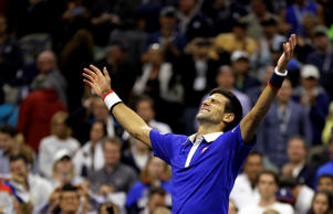 Novak Djokovic, of Serbia, reacts after defeating Roger Federer, of Switzerland, in the men's championship match of the U.S. Open tennis tournamenton Sept. 13 in New York.