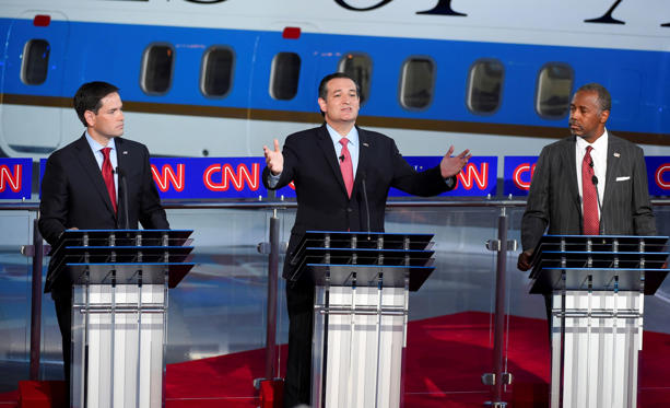 Republican presidential candidate, Sen. Ted Cruz, R-Texas, center, speaks as Marco Rubio, left, and Ben Carson look on during the CNN Republican presidential debate.