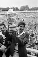 File photo dated 25-06-1983 of Kapil Dev, captain of India's Prudential World Cup cricket team, holding the trophy aloft, after beating the West Indies.