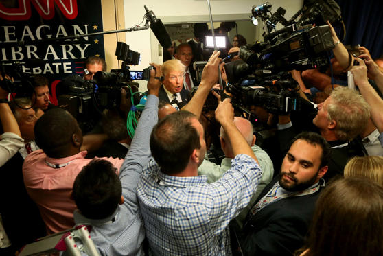 Republican presidential candidate Donald Trump speaks with reporters after the presidential debate.