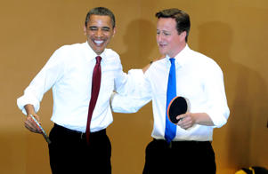U.S. President Barack Obama and British Prime Minister David Cameron play table tennis at Globe Academy on May 24, 2011 in London, England.
