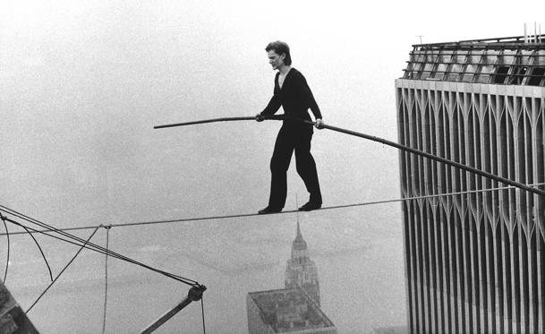 "Slide 1 of 29: In this Aug. 7, 1974 file photo, Philippe Petit, a French high wire artist, walks across a tightrope suspended between the World Trade Center's Twin Towers in New York. Philippe Petit stars in ""Man on a Wire,"" directed by James Marsh."