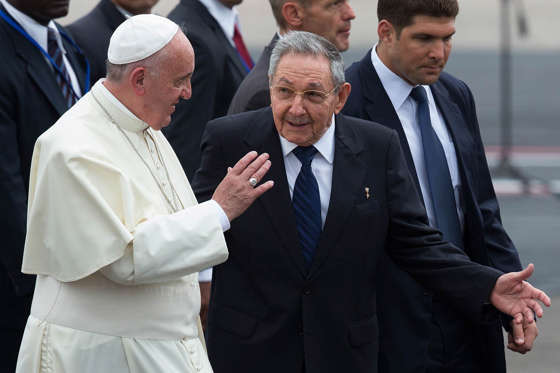Pope Francis walks with Cuba's President Raul Castro as he arrives at Jose Marti International Airport on September 19, 2015 in Havana, Cuba.